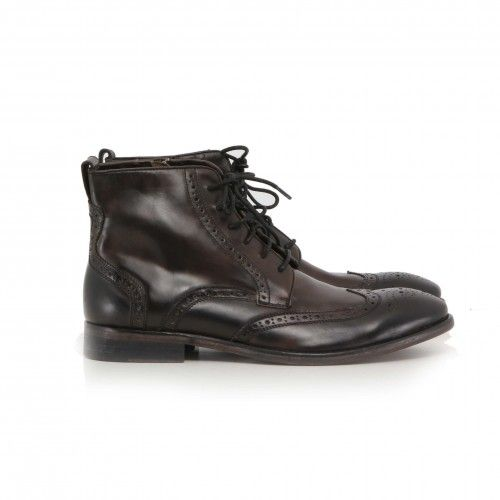 John Varvatos Dearborn NYC Wingtip Boot. Canvas panels create a casual contrast against time-worn leather on these wingtip boots detailed with distinctive broguing with a lace-up closure and an exposed side zip.