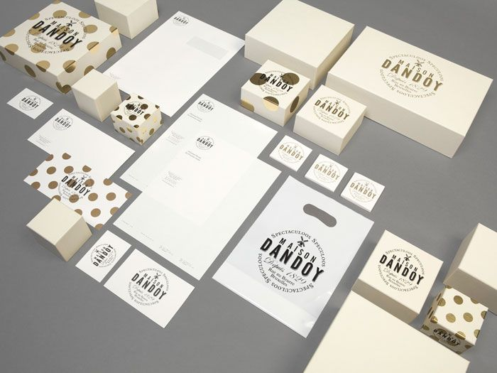 Maison Dandoy: A new visual identity for Brussels' most famous biscuit bakery with a pattern taking its inspiration from baked cookies being taken out of the oven.