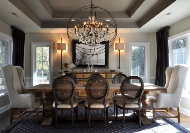 Foucault Chandelier Orb In Transitional Dining Room Dining Room Light Fixtures Transitional Dining Room Decor Dining Room Chandelier