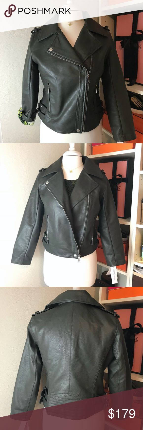 BCBG Green Moto Jacket - Vegas Leather / Faux Gorgeous green motorcycle jacket with floral green interior that can be seen if you roll or fold sleeves up. Clip closure at bottom front to keep jacket closed even if unzipped. Overlapped front classic moto design like the BCBG Ella jacket. Great detailing throughout.   🎗Sale proceeds are donated, so TY in advance. See my profile for info. ✨ BCBGeneration Jackets & Coats