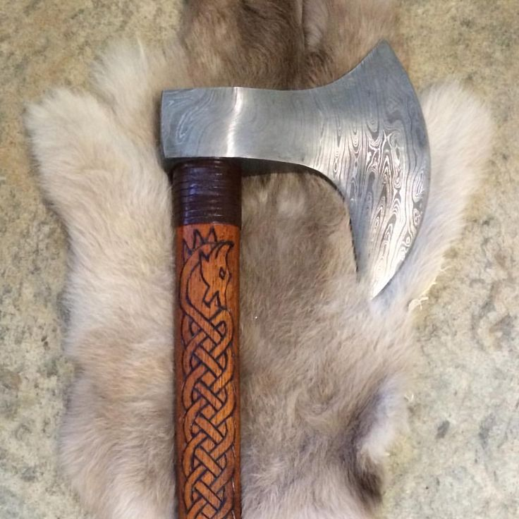 Close up of a new Hand forged Damascus Viking axe with ...