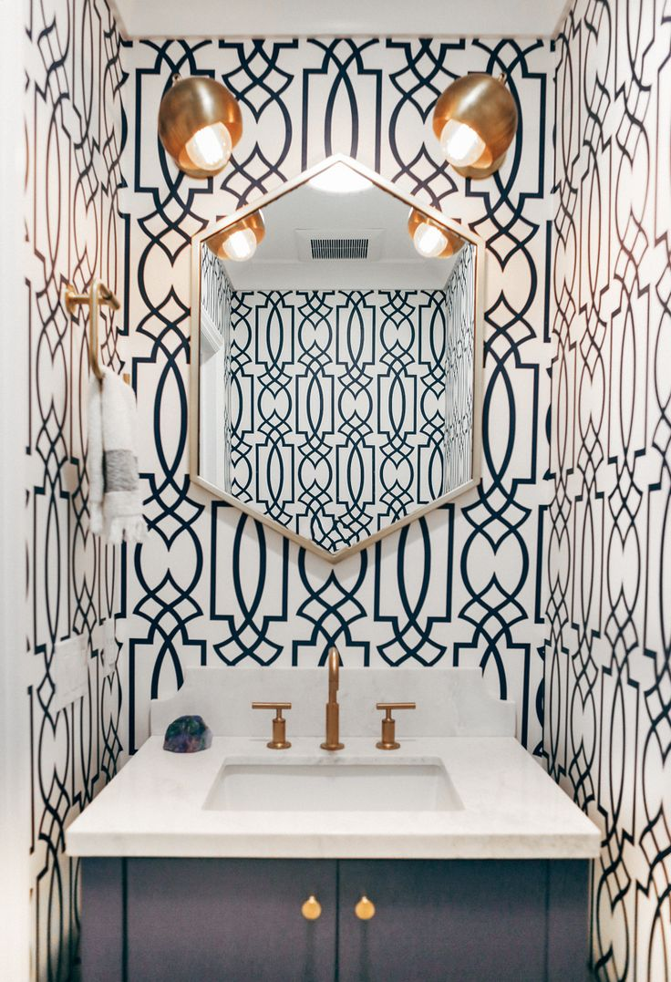Final powder room that used to be a closet. List of materials:   * Kohler purist faucet * West elm metal hex mirror * York Wallcoverings Watercolors Large Lattice wallpaper * Cedar & Moss lights. * Custom counter top * Some random black vanity I painted dark blue.