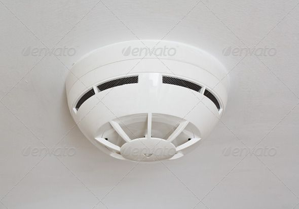 Ceiling mounted white fire detector used to activate warning systems in residential buildings. http://photodune.net/item/heat-detector/5685947