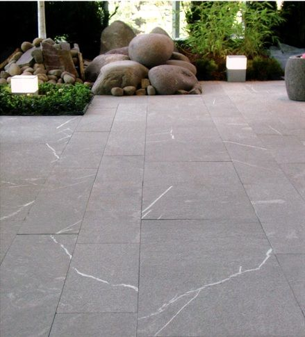 San Georgio limestone tiles laid in various tile sizes - feels very natural and raw