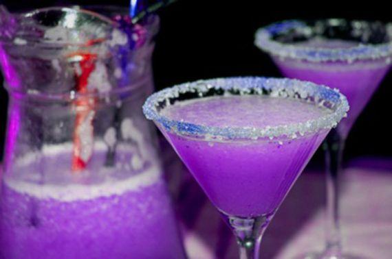 Purple Martini: 3oz vodka, 1 1/2oz cranberry juice, 1/2oz blue curacao liqueur, 1/2oz sweet and sour mix and 1/2oz of 7-up