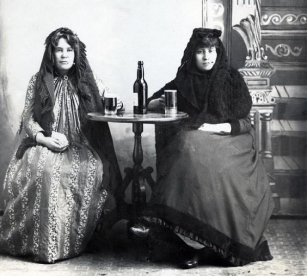 Brothel owner Bismarck Anne and a lady named Crazy Horse enjoy a hard-earned drink.