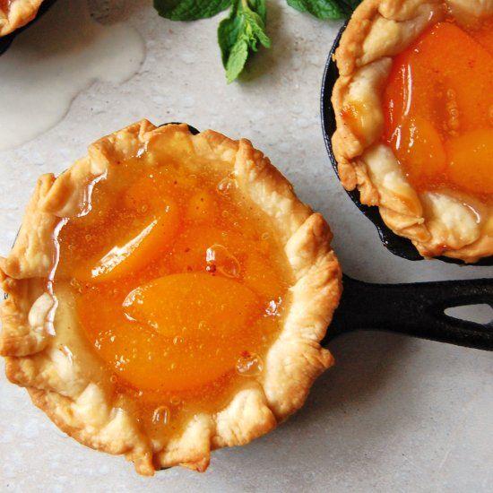Peach Pies in mini cast iron skillets.