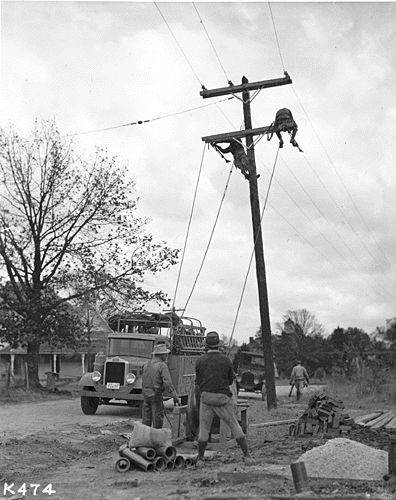Lineman on a Utility Pole, Tennessee Valley Authority (Rural Electrification Program),  Franklin D. Roosevelt Presidential Library