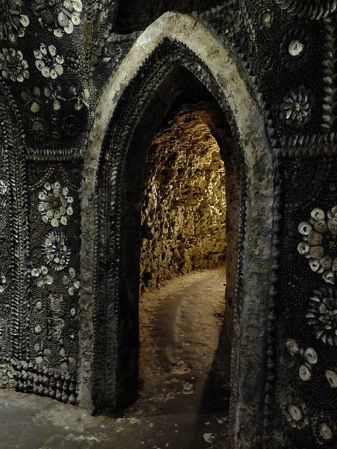 Inside Margate's Shell Grotto - discovered in 1835, although its actual age and origin is unknown. The grotto is a 70ft passageway ending at the Altar Room, a small rectangular chamber 15 by 20ft. The grotto gets its name from the 4.6m shells that decorate the interior with geometric patterns and stylised imagery.