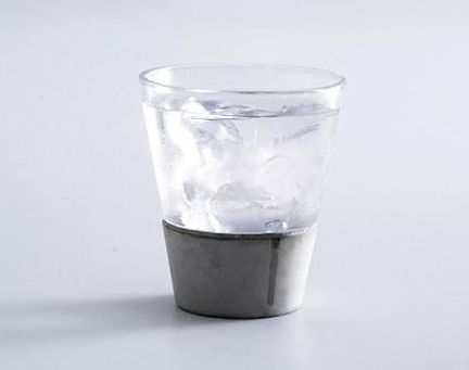 concrete glasses are hand made of glass and high water-absorption concrete. An ingenious combination of two materials resulting in a beautiful drinking glass.