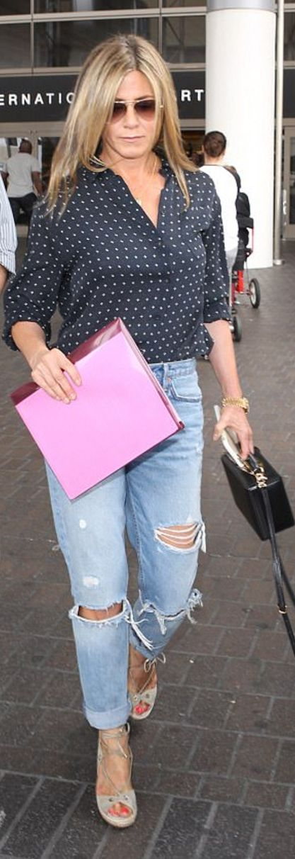 Who made Jennifer Aniston's aviator sunglasses, gold leaf necklace, blue ripped jeans, black box handbag, and print button top?