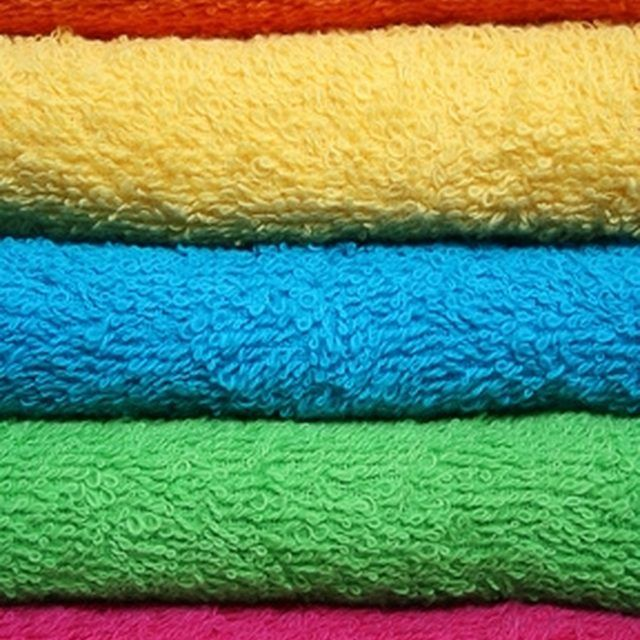 Adding 1/2 cup of baking soda when washing towels decreases lint, removes odors, and makes them softer.