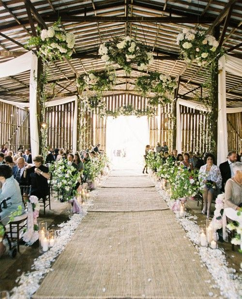Beautiful barn wedding aisle with burlap runner.