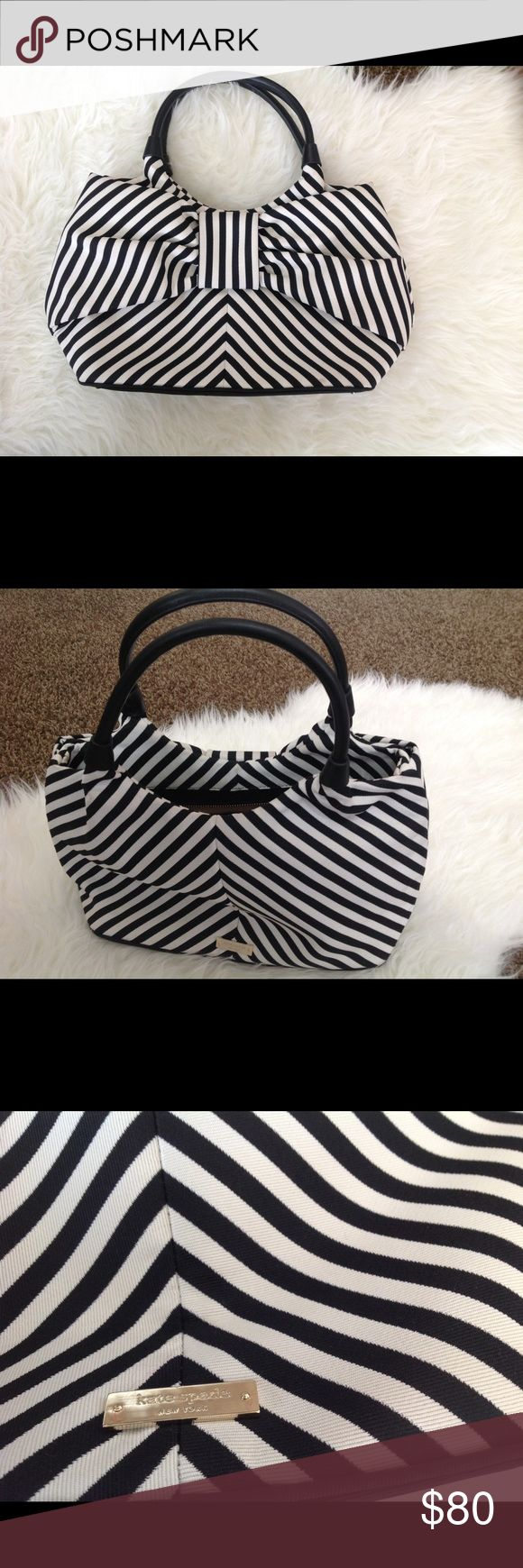 Kate Spade black and white stripe bow purse Kate Spade black and white stripe bow purse. Only used a couple times, no signs of wear. kate spade Bags