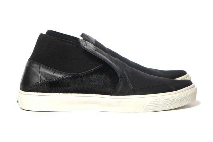 In recent years, slip-on shoes havereemerged as the footwear choice for many. As part ofStone Island Shadow Project's expanding accessories range, the Italian labelis offering a newiteration toth...