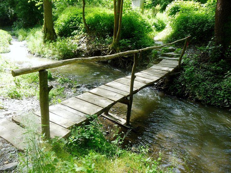 simple wooden footbridge over a creek