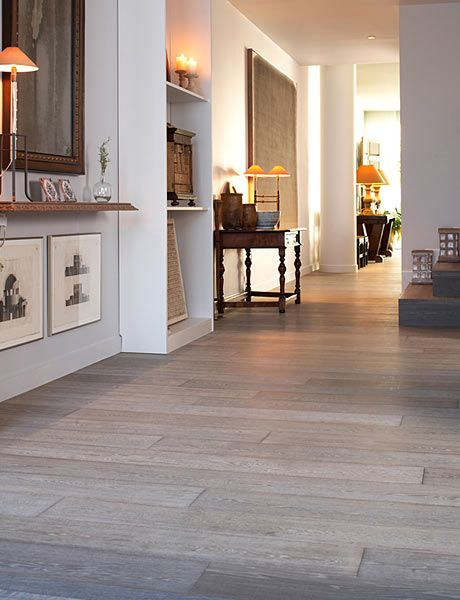 Grey Wood Floors- these are the ones I have in my house... Mr is convinced that we need to color our walls. I like them bright white