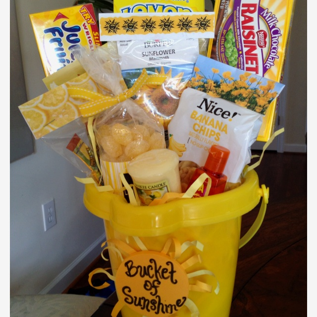 Bucket of sunshine filled with yellow gifts. Would be fun for the kids to wake up to this 1 morning