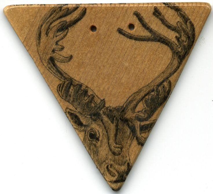 Pendant. Reindeer drawn on wood with Chinese ink, lackered. The holes are for the leatherstring. By www.najaabelsendk