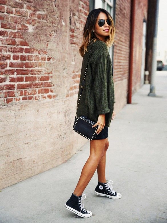 Sincerely Jules in oversized army green sweater + black studded purse + black and white converse