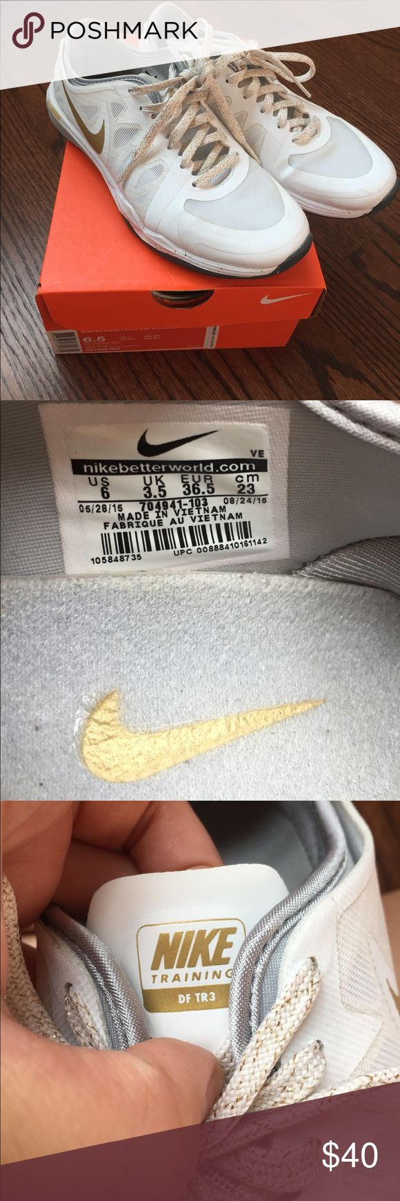 Nike dual fusion 3 training shoes Nike shoes in white and gold. Never worn outside he house. Like new. Only one scuff shown in photos. Very light weight. Only getting rid of because they're a little tighter than I'd like. Nike Shoes Sneakers