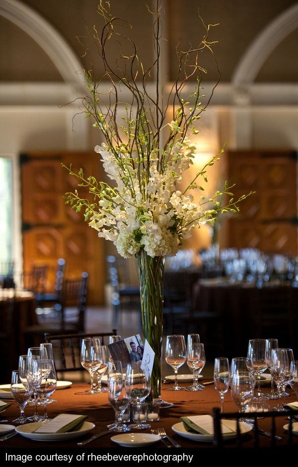 Tall Centerpiece Design With Curly Willow Branches Dendrobium Orchids And Hydrangea Reception