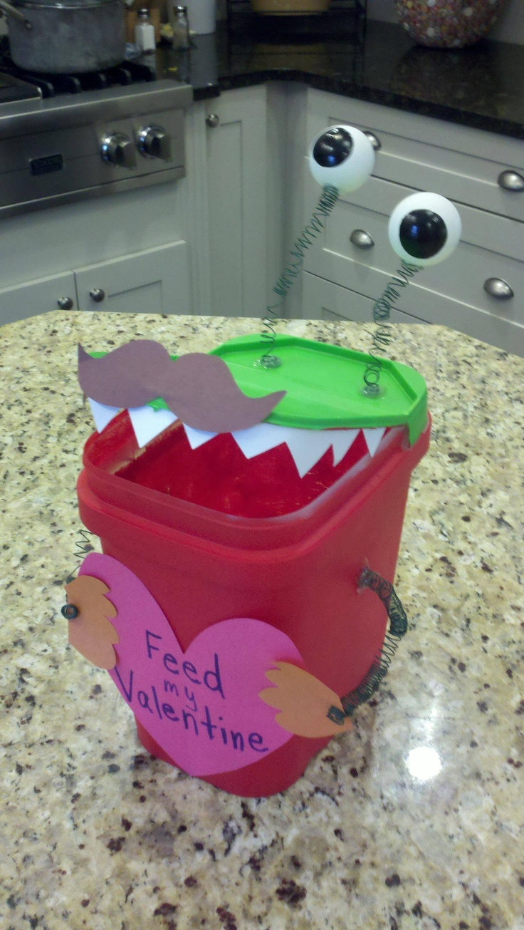 My sons recycled Valentine box!!!  Made from a dishwasher tablet tub, ping pong balls, floral wire and construction paper!  Everything on hand at my house!!  And I had to put my signature mustache on it as well...lol