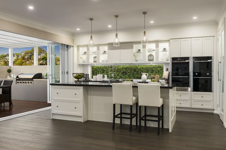 How would you love to cook in this beautiful #hamptons style #kitchen? This is from our Miami Executive in Sapphire Beach, Coffs Harbour. For details see http://mcdonaldjoneshomes.com.au/display-home-locations/sapphire-beach #kitchen #décor #interiordesign #design #home #newhome #islandbench #stools #stool #cabinetry #pendantlights #splashback #pendants #timberfloors #timber #hamptonsstyle #homestyle