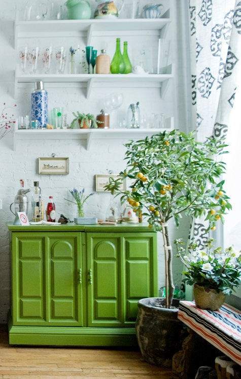 The green...the Moroccan-tile-esque curtains...the lemon tree. The shelves.  I love them all.