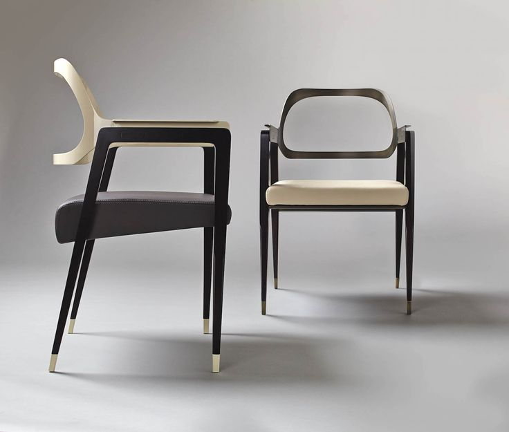 The chair is available in two color versions, one with a pale cream leather seat and burnished brushed metal, and a chair with smoke gray painted metal and ivory leather seat.
