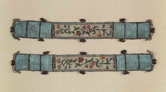French, 18th century     Dimensions      6.2 x 37.1 cm (2 7/16 x 14 5/8 in.)  Medium or Technique      Sablé glass bead work on silk ribbon with silver lace edging