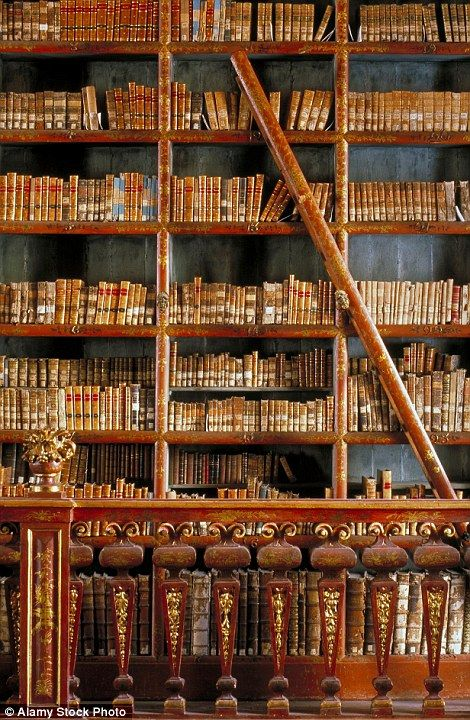 The Joanina Library (Biblioteca Joanina) is the Baroque library of the University of Coimbra in Portugal with the walls covered by two-storied shelves, in gilded or painted exotic woods