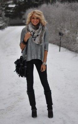 Black boots over black pants = longer legs (: Minus fur.