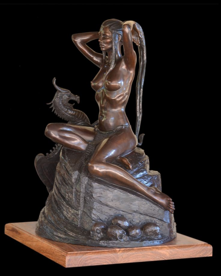 Die Lorelei.  Depicts the German legend of the beautiful maiden sitting on a rock above the Rhine, diverting sailors' attention, causing them to wreck their ships. 820 mm high.