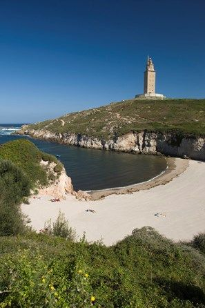 SMALL BEACH IN COVE TOWER OF HERCULES ROMAN LIGHTHOUSE LA CORUNA GALICIA SPAIN
