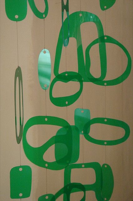 A mobile made from shapes cut from a plastic 2 liter soda bottle.  Funky.