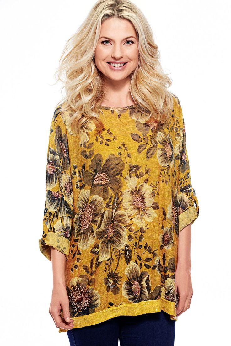 Floral Printed Top With Sequin Embellishments £25.00 The sleeves on the Robyn patterned tops can be rolled up and buttoned in place or let down if you prefer a long sleeve. Sequins feature along the hemline to create some extra sparkle! Plus FREE matching scarf. One size fits 10-16. 80% cotton, 15% polyester, 5% elastane. Machine washable.