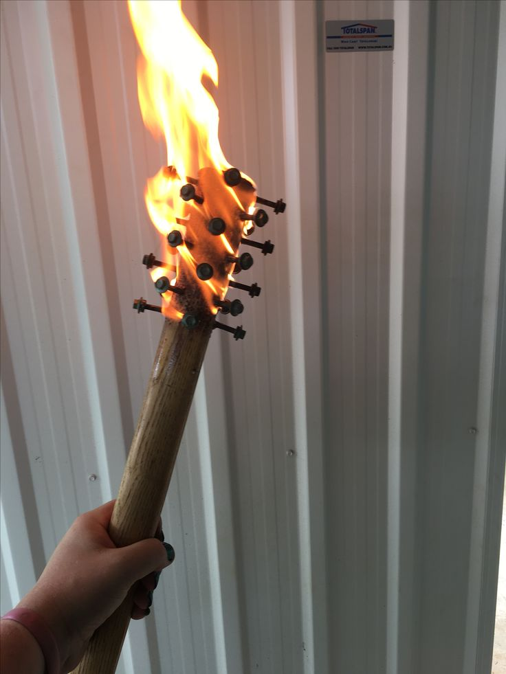 Pick handle + roofing screws + lighter fluid = Zombie Defence Mace