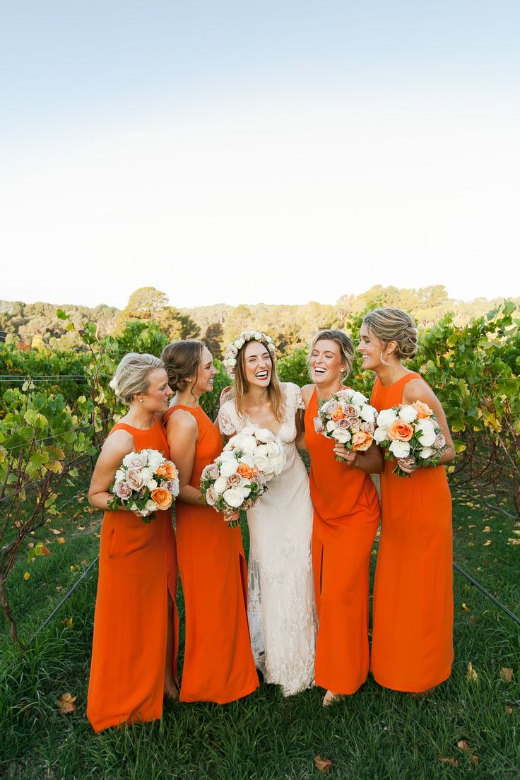 Long orange maids dresses. Willow. Photography: Kate Robinson Photography - www.katerobinsonphotography.com/  Read More: http://www.stylemepretty.com/2014/06/17/modern-and-whimsical-orange-wedding-in-australia/