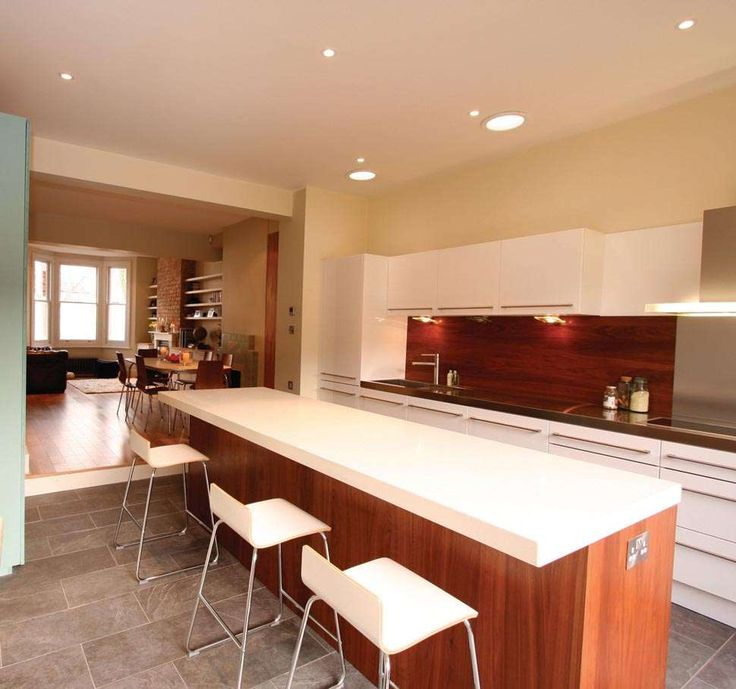 Extended Kitchen with nice island Gloss White cupboards ideal terrace extension idea