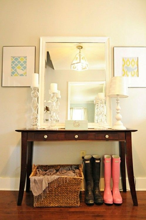 home entry table? really like all the frames/mirrors stacked with the lamp. and antiquey/simple table. :)