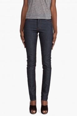 Skinny jeans with mid rise in dark indigo raw denim. Five pocket styling with copper tone rivets. Acne embossed logo on front button. Leather logo patch at back waist. Contrast stitching in orange. Zip fly. Machine wash warm. Imported.