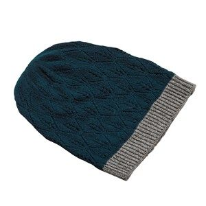 SUPERSOFT hat, petrol. The season's softest hat. Knitted with a beautiful leaf pattern and glitter hem, which makes it simple and exclusive. Made in sustainable wool from our Italian supplier.