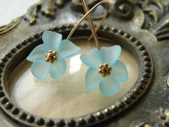 Lucite flower earrings in aqua on gold filled wire accented with tiny vermeil daisy beads. Very lightweight earrings.  Measurements: Overall length: 1 1/4 inces from top of earring Width: 5/8 inch
