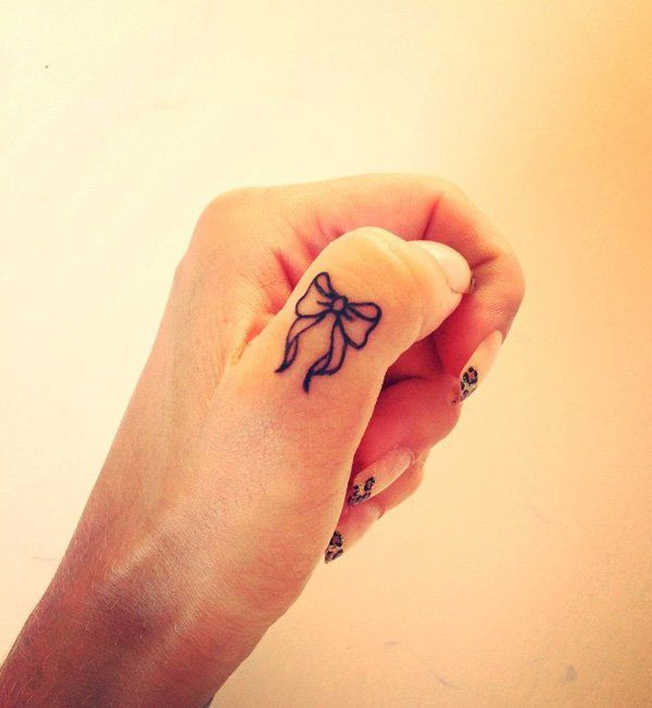 Bow Finger Tattoo. - 55+ Cute Finger Tattoos | Art and Design