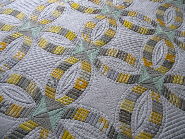 Stunning Sew Kind Of Wonderful Finished Metro Rings Find this Pin and more on Double Wedding Ring quilts