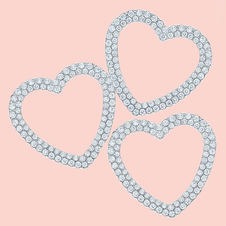 Tiffany diamonds are always the perfect way to dazzle your valentine. Tiffany Metro heart pendants in 18k white gold with diamonds.