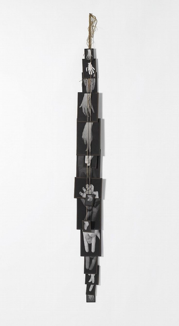 Annette Messager (1943). MES VOUEX, numbered consecutively on the reverse of each element, black and white photographs, tape and string assemblage in artist's frame, in 16 parts overall: 118 by 6 in. 299.7 by 15.2 cm. Executed in 1989.