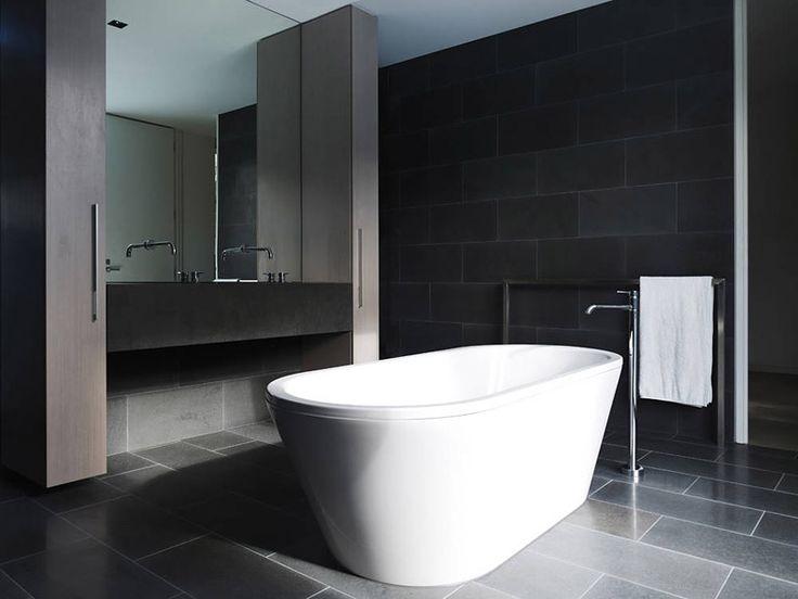 bathroom with wooden cupboards black tile