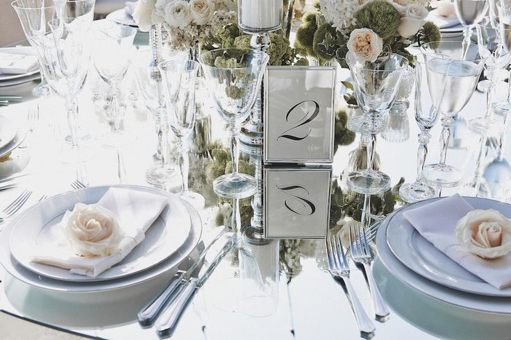 Table numbers were printed on white cards and displayed in silver frames. #PlaceSetting Photography: Daniel Kincaid Photography. Read More: http://www.insideweddings.com/weddings/brittney-palmer-and-aaron-zalewski/595/